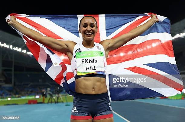 Jessica EnnisHill of Great Britain celebrates winning a silver medal in the Women's Heptathlon on Day 8 of the Rio 2016 Olympic Games at the Olympic...