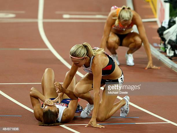 Jessica Ennis-Hill of Great Britain collapses after crossing the finish line to win the Women's Heptathlon 800 metres and the overall Heptathlon gold...