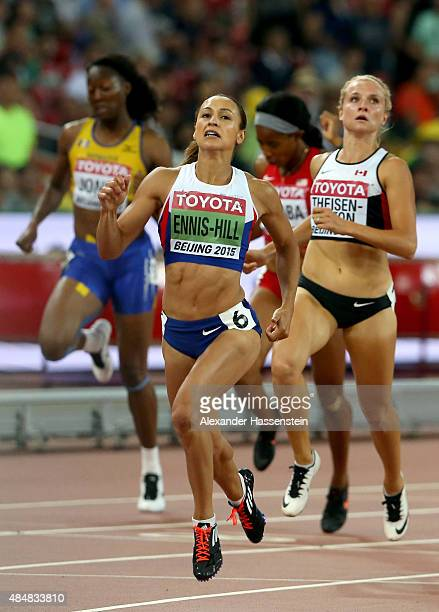 Jessica EnnisHill of Great Britain crosses the finish line in the Women's Heptathlon 200 metres during day one of the 15th IAAF World Athletics...