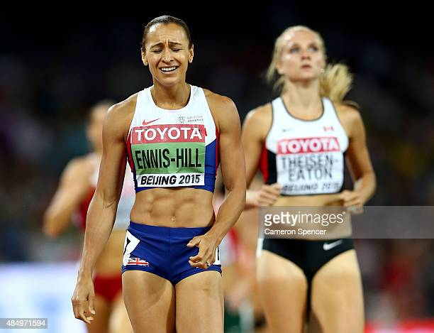Jessica Ennis-Hill of Great Britain crosses the finish line to win the Women's Heptathlon 800 metres and the overall Heptathlon gold during day two...