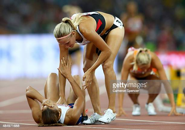 Jessica Ennis-Hill of Great Britain is congratulated by Brianne Theisen Eaton of Canada after crossing the finish line to win the Women's Heptathlon...