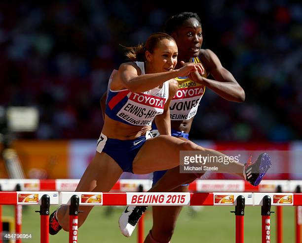 Jessica EnnisHill of Great Britain leads Akela Jones of Barbados in the Women's Heptathlon 100 metres hurdles during day one of the 15th IAAF World...