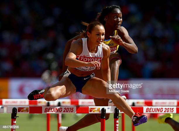 Jessica Ennis-Hill of Great Britain leads Akela Jones of Barbados in the Women's Heptathlon 100 metres hurdles during day one of the 15th IAAF World...