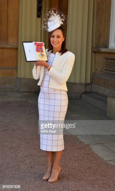 Jessica EnnisHill poses with her award after she was made a Dame CBE by the Duke of Cambridge during an investiture ceremony at Buckingham Palace on...