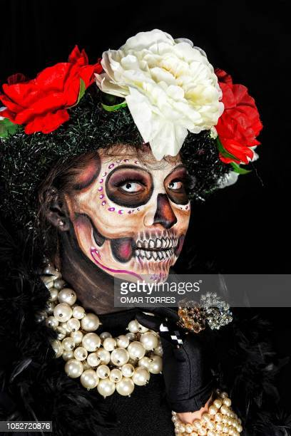 Jessica Esquivias organizer of the Body Paint March of Catrinas poses for a photograph disguised as Catrina before the beginning of the march in...