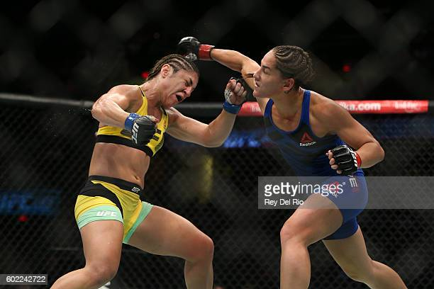 Jessica Eye exchange punches Bethe Correia during the UFC 203 event at Quicken Loans Arena on September 10 2016 in Cleveland Ohio