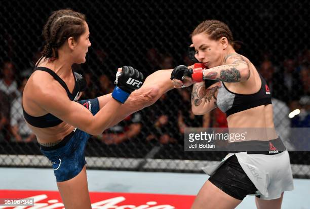Jessica Eye kicks JessicaRose Clark of Australia in their women's flyweight bout during the UFC Fight Night event at the Singapore Indoor Stadium on...