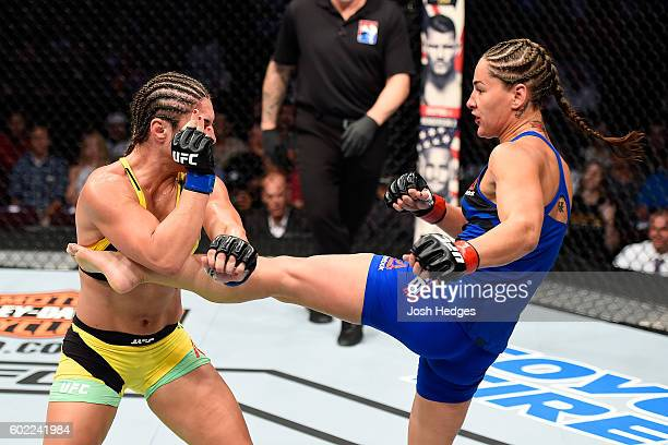 Jessica Eye lands a kick to the body of Bethe Correia of Brazil in their women's bantamweight bout during the UFC 203 event at Quicken Loans Arena on...