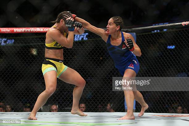 Jessica Eye punches Bethe Correia during the UFC 203 event at Quicken Loans Arena on September 10 2016 in Cleveland Ohio