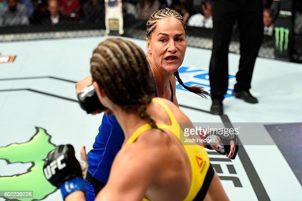 Jessica Eye punches Bethe Correia of Brazil in their women's bantamweight bout during the UFC 203 event at Quicken Loans Arena on September 10 2016...