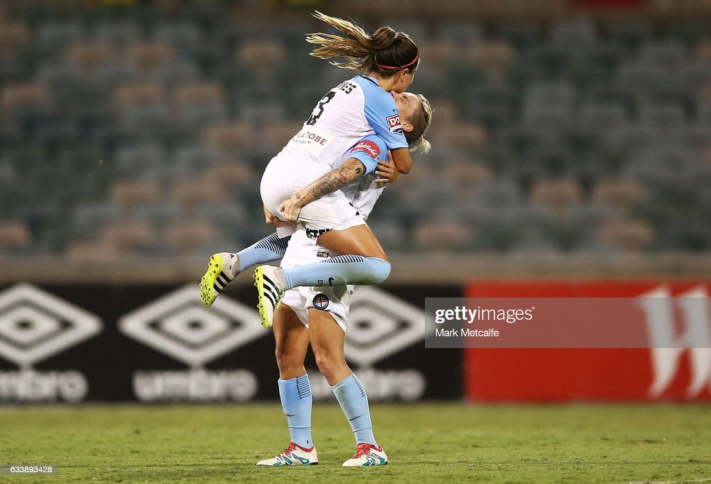 Jessica Fishlock and Lauren Barnes of Melbourne City celebrate victory at the end of the W-League Semi Final match between Canberra United and Melbourne City FC at GIO Stadium on February 5, 2017 in Canberra, Australia.