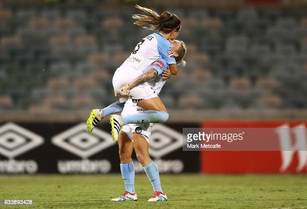 Jessica Fishlock and Lauren Barnes of Melbourne City celebrate victory at the end of the WLeague Semi Final match between Canberra United and...