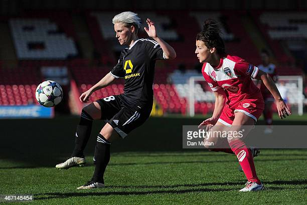 Jessica Fishlock of FFC Frankfurt holds off Angharad James of Bristol during the UEFA Womens Champions League Quarter Final match between Bristol...