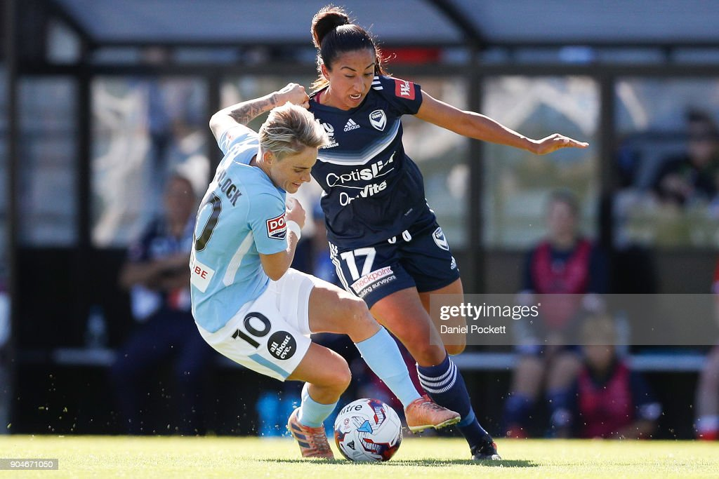 Jessica Fishlock of Melbourne City and Gulcan Koca of Melbourne Victory contest the ball during the round 11 W-League match between the Melbourne Victory and Melbourne City at Epping Stadium on January 14, 2018 in Melbourne, Australia.