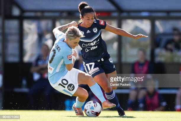 Jessica Fishlock of Melbourne City and Gulcan Koca of Melbourne Victory contest the ball during the round 11 WLeague match between the Melbourne...