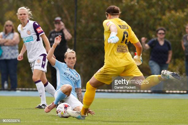 Jessica Fishlock of Melbourne City and Perth Glory goalkeeper Melissa Maizels contest the ball during the round ten WLeague match between Melbourne...