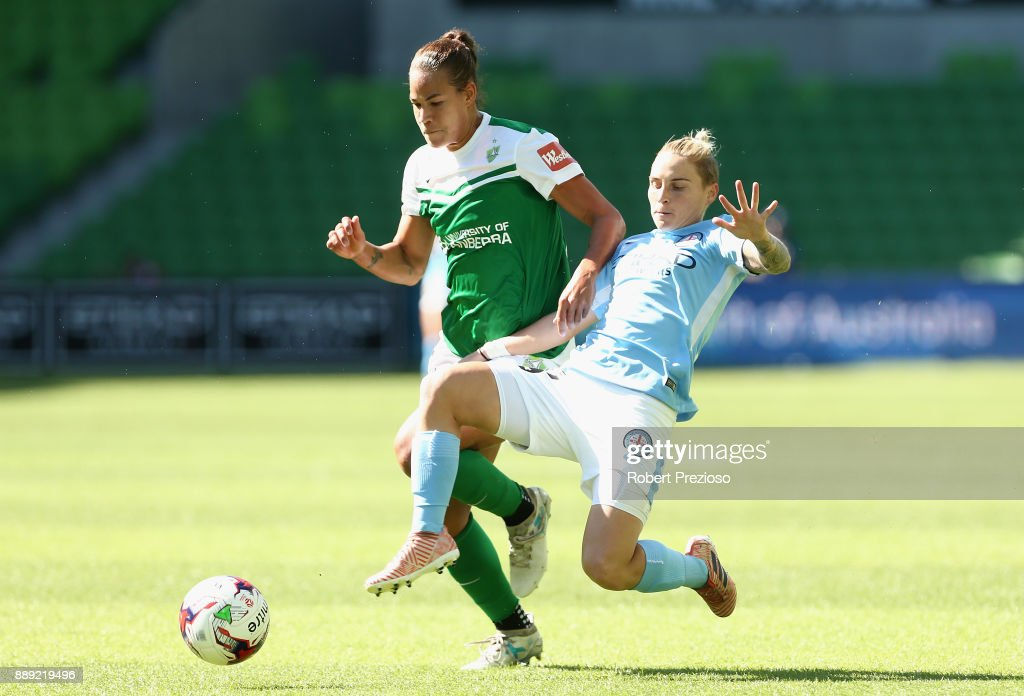 Jessica Fishlock of Melbourne City contests the ball during the round seven W-League match between Melbourne City and Canberra United at AAMI Park on December 10, 2017 in Melbourne, Australia.