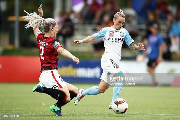 Jessica Fishlock of Melbourne City is tackled by Caitlin Cooper of the Wanderers during the round seven WLeague match between the Western Sydney...