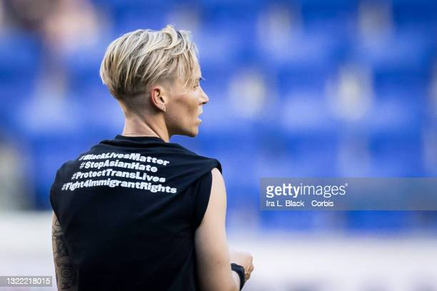 Jessica Fishlock of OL Reign wears a tee shirt that says on the back #BlackLivesMattter #StopAsianHate #ProtectTransLives and #Fight4ImmigrantRights...