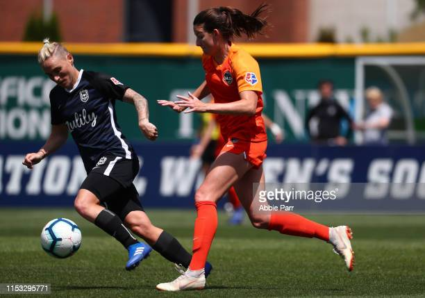 Jessica Fishlock of Seattle Reign FC dribbles with the ball against CeCe Kizer of Houston Dash in the second half during their game at Cheney Stadium...