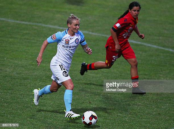 Jessica Fishlock of the City runs with the ball away from Alexandra Chidiac of United during the round 10 WLeague match between Melbourne City and...