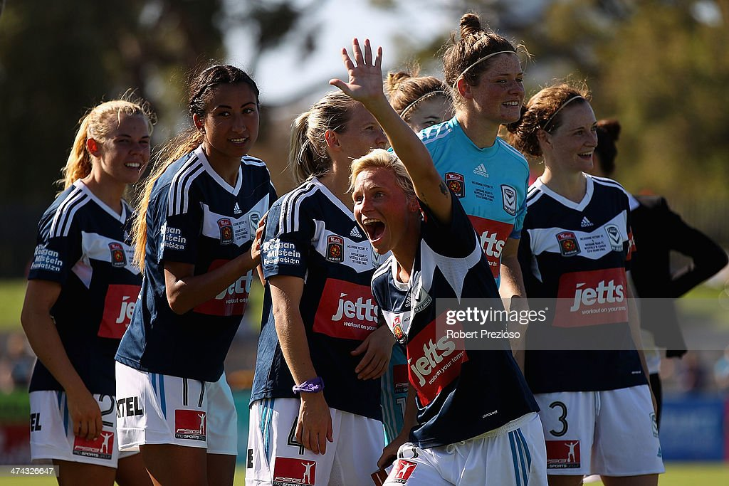Jessica Fishlock of Victory celebrates after winning the W-League Grand Final match between the Melbourne Victory and the Brisbane Roar at Lakeside Stadium on February 23, 2014 in Melbourne, Australia.