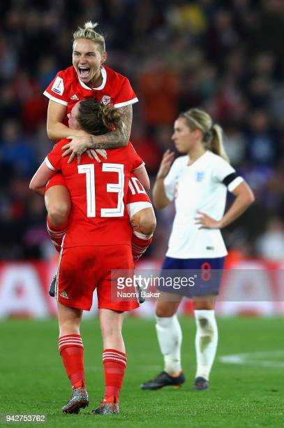Jessica Fishlock of Wales celebrates with Rachel Rowe of Wales at the full time whistle during the Women's World Cup Qualifier between England and...