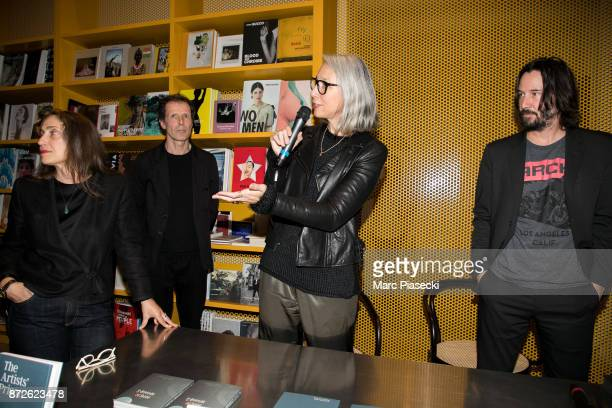Jessica Fleischmann Benoit Fougeirol Alexandra Grant and actor Keanu Reeves attend the 'X Artists' books launch at Palais De Tokyo on November 10...