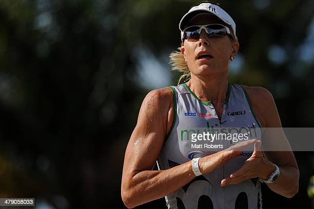 Jessica Fleming of Australia competes during the run stage of the Batemans Bay leg of Challenge Australia on March 16 2014 in Ulladulla Australia