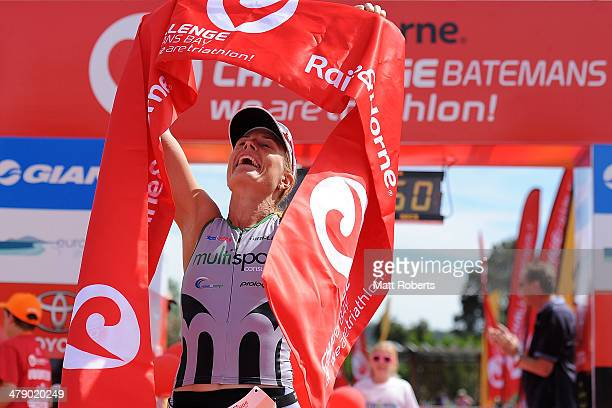 Jessica Fleming of Australia reacts after crossing the finish line in second place during the Batemans Bay leg of Challenge Australia on March 16...