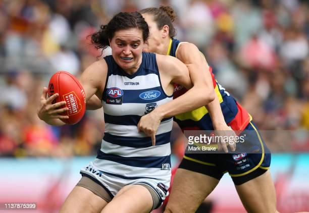 Jessica Foley of the Adelaide Crows tackles Meghan McDonald of the Cats during the AFLW Preliminary Final match between the Adelaide Crows and thew...