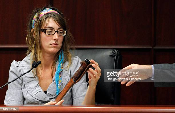 Jessica Foote Jason Williford's exwife looks at a knife that she kept under her bed as she testifies in Williford's murder trial in a Wake County...