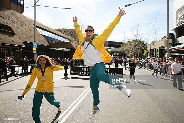Jessica Fox and Dave Smith celebrate during the Australian Olympic Team Homecoming Parade in the Sydney CBD on August 20 2012 in Sydney Australia
