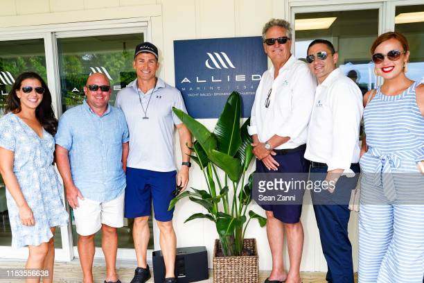 Jessica Frank Eric Frank Tyler Appleby Jon Burkard Alex Thompson and Elizabeth Hurley attend Allied Marine Yacht Hop In Sag Harbor at Sag Harbor Cove...