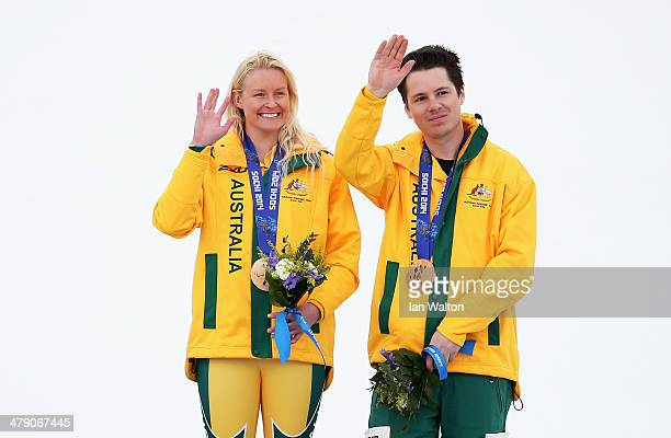 Jessica Gallagher of Australia and guide Christian Geiger celebrate winning the bronze medal during the medal ceremony for the Women's Giant Slalom...