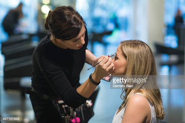 Jessica Ginkel is getting make up during a shoot for AMREF in Salon Shan Rahimkhan on December 16 2013 in Berlin Germany