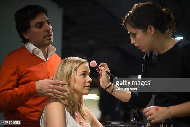 Jessica Ginkel is getting make up during a shoot for AMREF in Salon Shan Rahimkhan while Shan Rahimkhan stands behind her on December 16 2013 in...