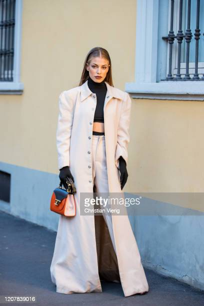 Jessica Goicoechea is seen wearing black cropped top, creme white coat and pants, Tods bag outside Tods during Milan Fashion Week Fall/Winter...