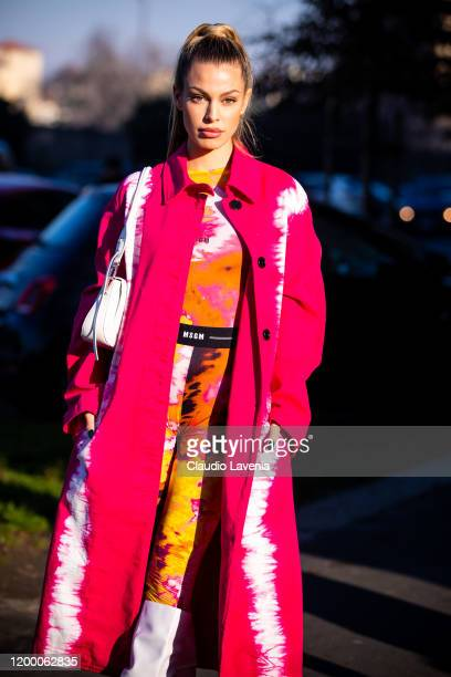 Jessica Goicoechea, wearing a printed MSGM jumpsuit, pink printed coat, white boots and white Prada bag, is seen outside the MSGM show during the...