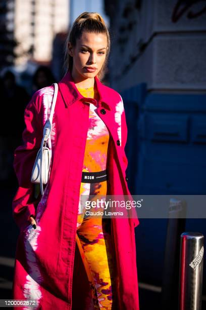 Jessica Goicoechea, wearing a printed MSGM jumpsuit, pink printed coat and white Prada bag, is seen outside the MSGM show during the Milan Men's...