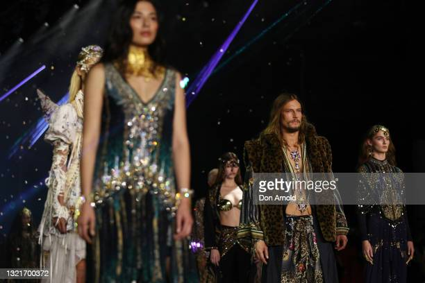 Jessica Gomes and David Genat walk the runway during the Afterpay's Future of Fashion show during Afterpay Australian Fashion Week 2021 Resort '22...