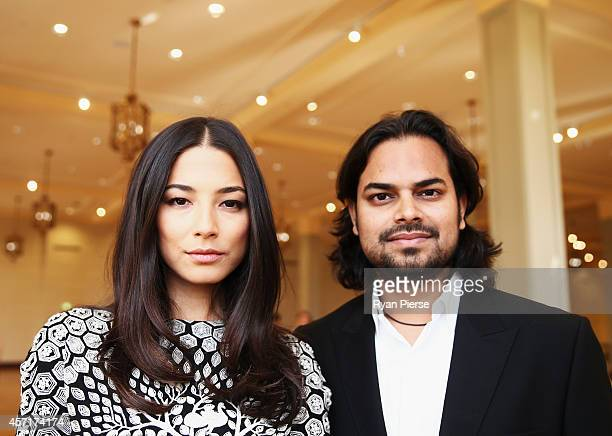 Jessica Gomes and Rahul Mishra pose as Rahul Mishra Launches His Woolmark Collection at David Jones Elizabeth Street Store on October 14 2014 in...