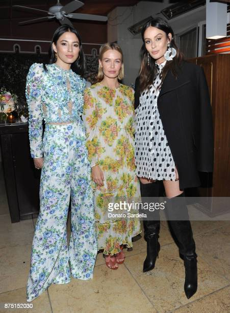 Jessica Gomes Lara Worthington and Nicole Trunfio at Zimmermann Los Angeles Dinner at Sunset Tower on November 16 2017 in West Hollywood California