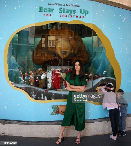 Jessica Gomes poses in front of a window display as children look at the display during the 2019 Christmas Window unveiling at David Jones Market...
