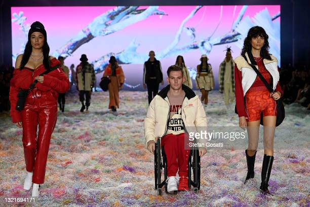 Jessica Gomes, Rheed McCracken and Charlee Fraser pose on the runway in a design by PE Nation during the Afterpay's Future of Fashion show during...