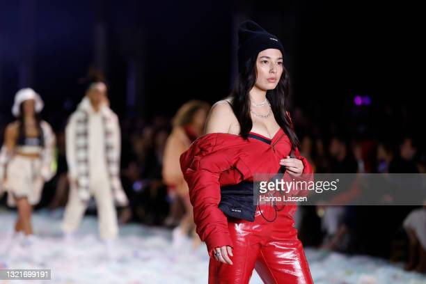 Jessica Gomes walks on the runway in a design by PE Nation during the Afterpay's Future of Fashion show during Afterpay Australian Fashion Week 2021...