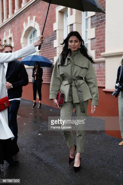 Jessica Gomes wearing Camilla and Marc suit and Stella McCartney clutch during MercedesBenz Fashion Week Resort 19 Collections at Royal Hall of...