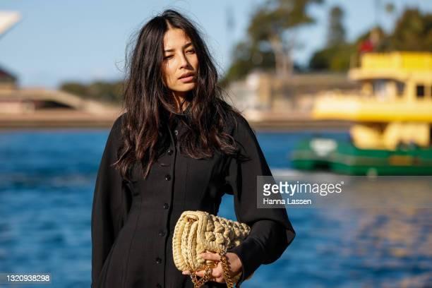 Jessica Gomes wearing Wynn Hamlyn black coat, Bottega Veneta shoes and bag and Cartier watch at Afterpay Australian Fashion Week 2021 on May 31, 2021...
