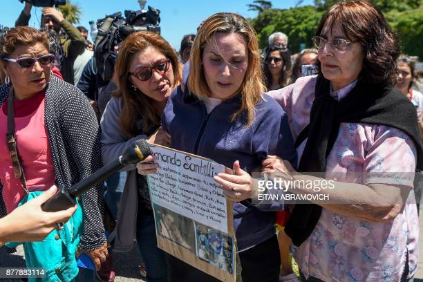 Jessica Gopar , wife of Fernando Santilli, one of the 44 crew members of Argentine missing submarine, expresses her grief outside Argentina's Navy...