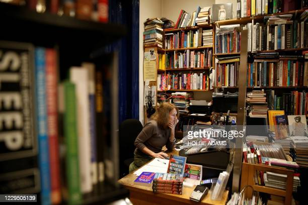 Jessica Graham, owner of independent book shop Primrose Hill Books, poses for a photograph in west London on November 6, 2020. - Some 250 small...
